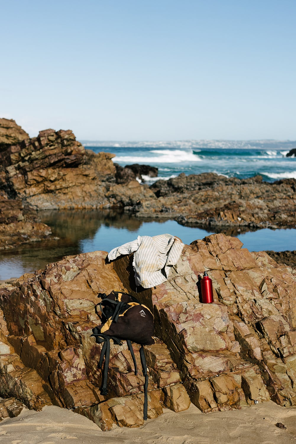 Mussel foraging with Mungo master weaver in Plettenberg Bay, Garden Route