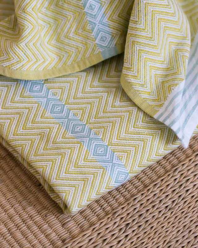 Mungo Soleil Tawulo colourful and vibrant bath sheet and beach towel in bright green with a blue stripe and african inspired pattern