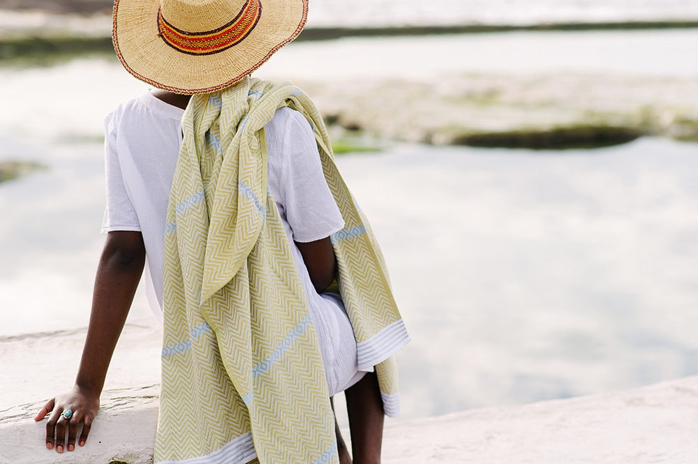The Mungo Soleil Tawulo towel in the sunlight being worn