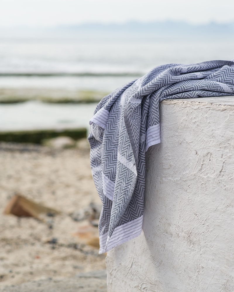 Mungo Tawulo Towel in Thunder Grey. A versatile, pure cotton flat weave towel made in South Africa at the Mungo Mill
