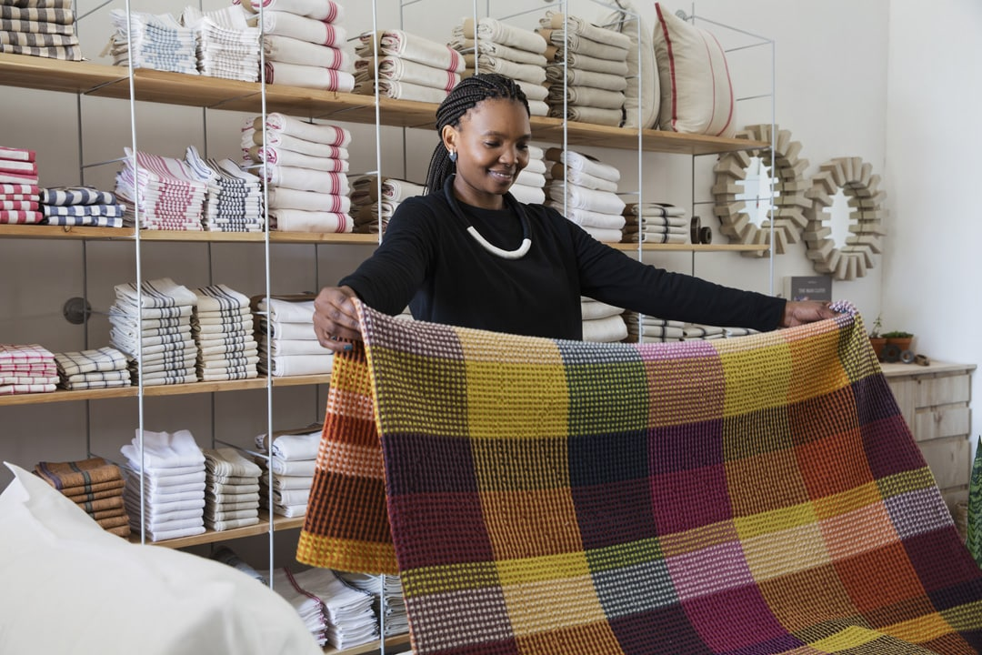 The Vrou-vrou is a checkered blanket woven from cotton and features here in the Mungo store at 44 Stanley in Johannesburg.