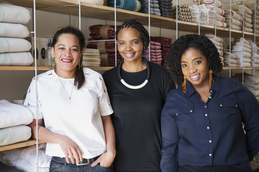 Cherilee, Phumzile and Sandy the Mungo Team at the Joburg store, standing in the newly renovated shop at 44 Stanley.