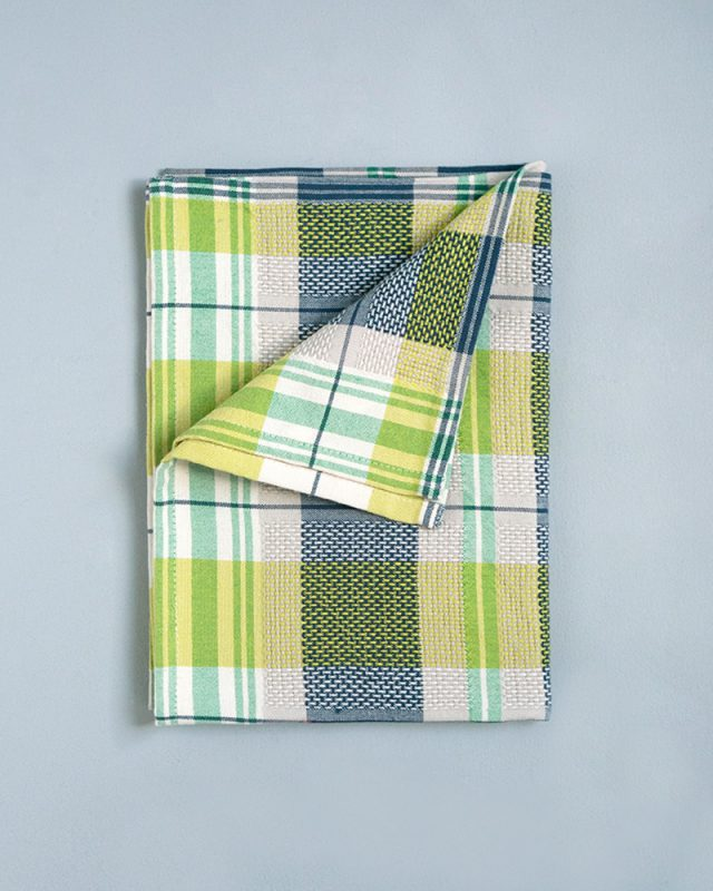 The Mungo Vadoek in the Dill colourway is woven at the Mungo mill in Plettenberg bay.