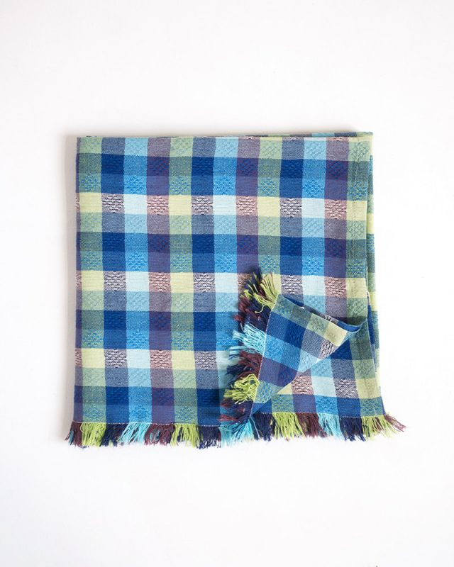 The Mungo overcheck scarf shown here in the Lake colourway. Woven at the Mungo mill in Plettenberg Bay.