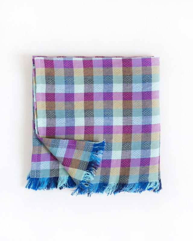 The Mungo overcheck scarf shown here in the Moroccan colourway. Woven at the Mungo mill in Plettenberg Bay.