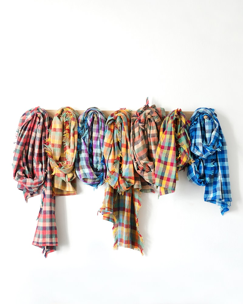 The Mungo overcheck scarf is available in a range of colours. Woven at the Mungo mill in Plettenberg Bay.