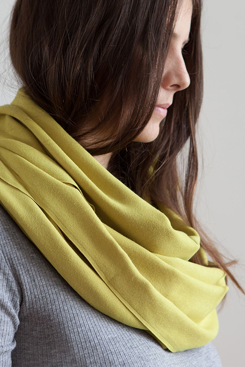 Girl wearing the Mungo Bamboo Infinity Scarf in Lime