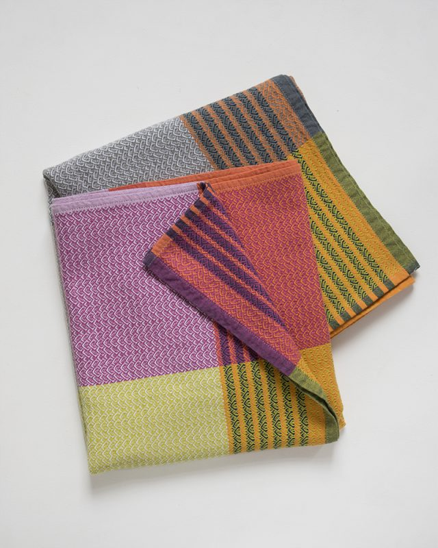 The Mungo Folly Towel shown here in the Frogmore Stew colourway is woven at the Mungo mill in South Africa.