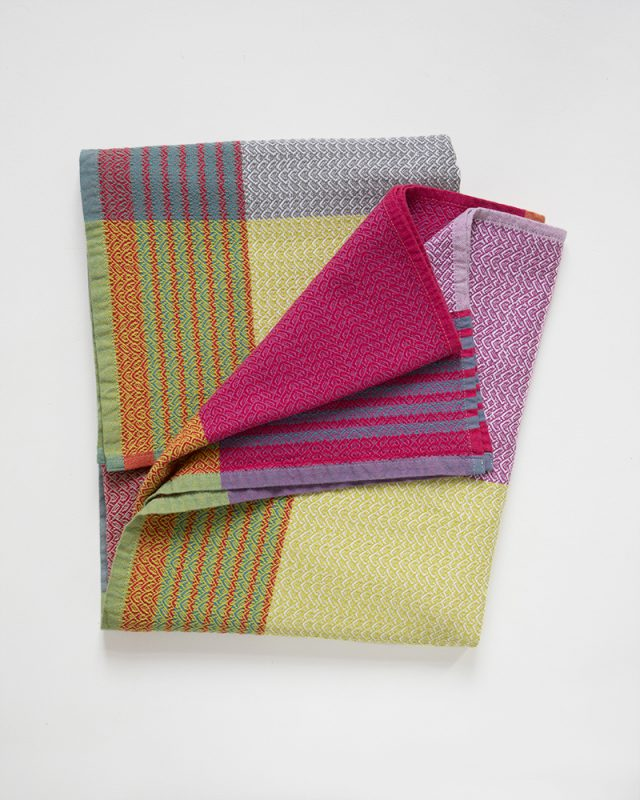 The Folly Towel in the Shrimp & Grits colourway is woven by Mungo at our mill in Plettenberg Bay