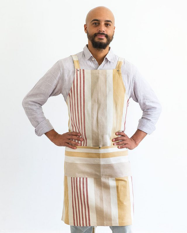 Model wearing the Mungo Chef's Apron in Yam, woven at our mill in Plettenberg Bay, South Africa