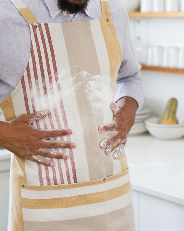 The Mungo Chef's Apron in Yam in a kitchen scene.