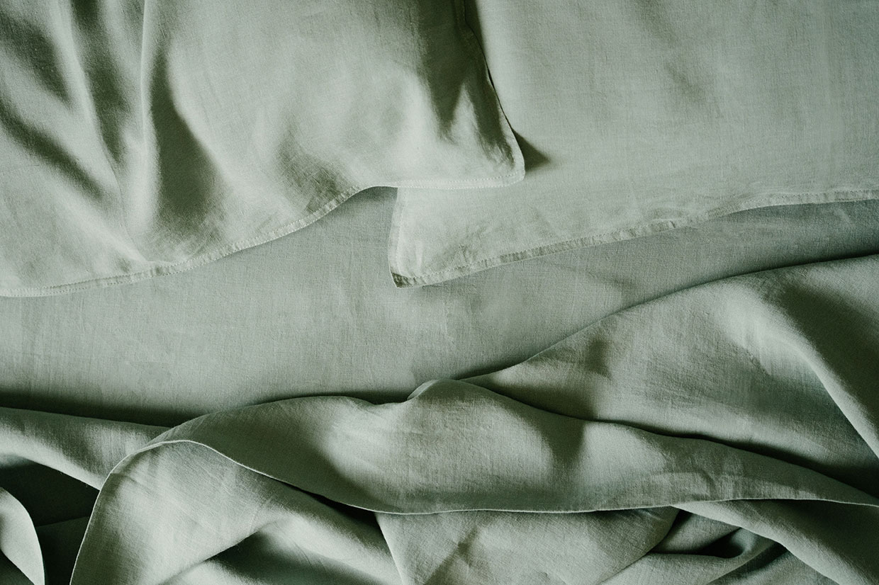 Pure linen bedding by Mungo in soft greeny verdite colour