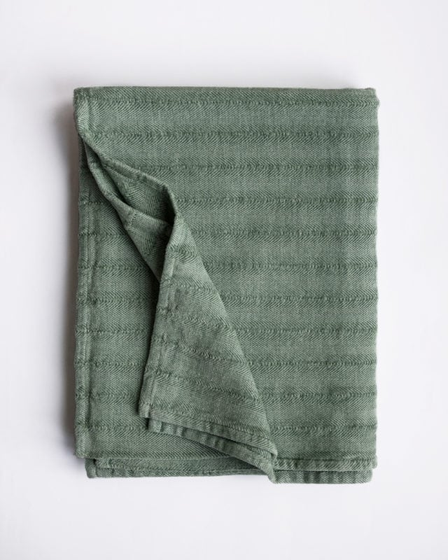 The Mungo Chenille Herringbone Throw in the Mineral colourway is woven at the Mungo mill in Plettenberg Bay from yarn dyed cotton