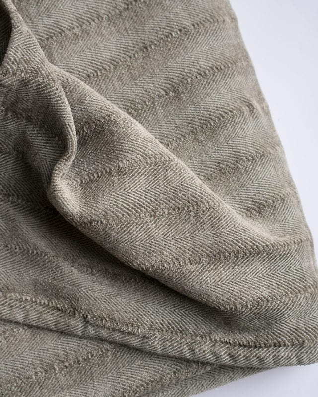 The Mungo Chenille Herringbone Throw in the Mystery colourway is woven at the Mungo mill in Plettenberg Bay from yarn dyed cotton
