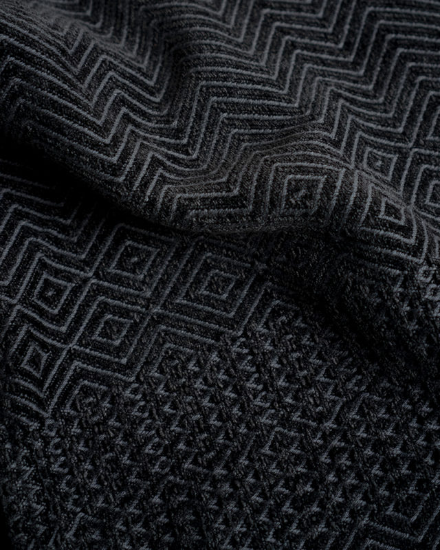 The Mungo Chenille ZigZag Throw in the Charcoal colourway is woven at the Mungo mill in Plettenberg Bay from yarn dyed cotton