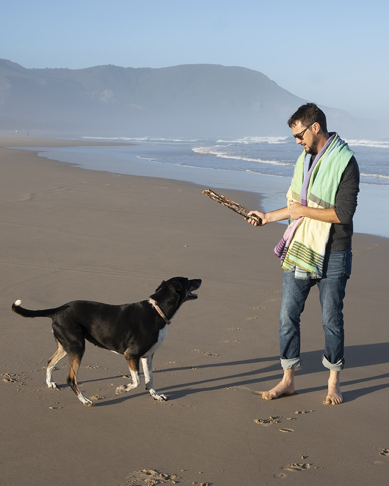 Mungo MD, Dax Holding at the beach with a Folly Beach Towel