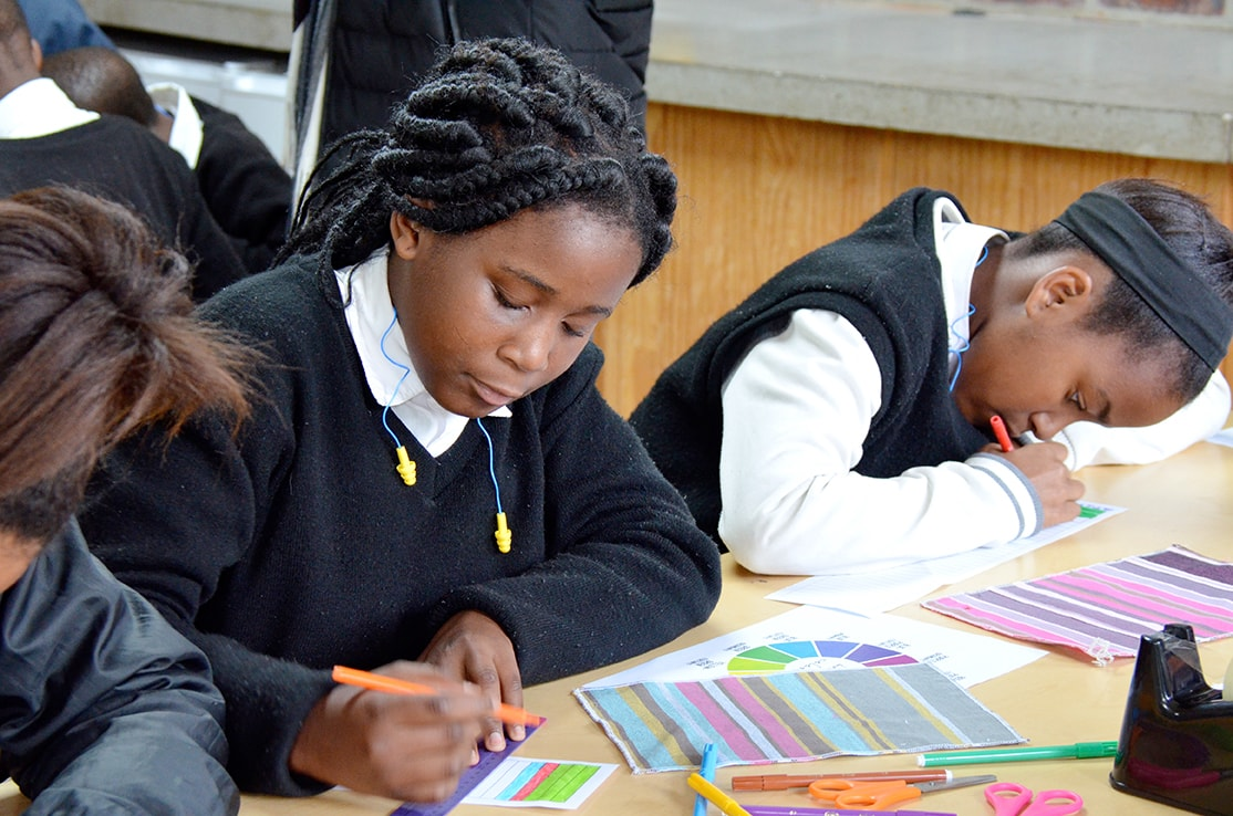 Crags Primary School students designing their own kikoi colourway for the Mungo Kids of Kurland Kikoi, as part of Mungo's MOVE initiative