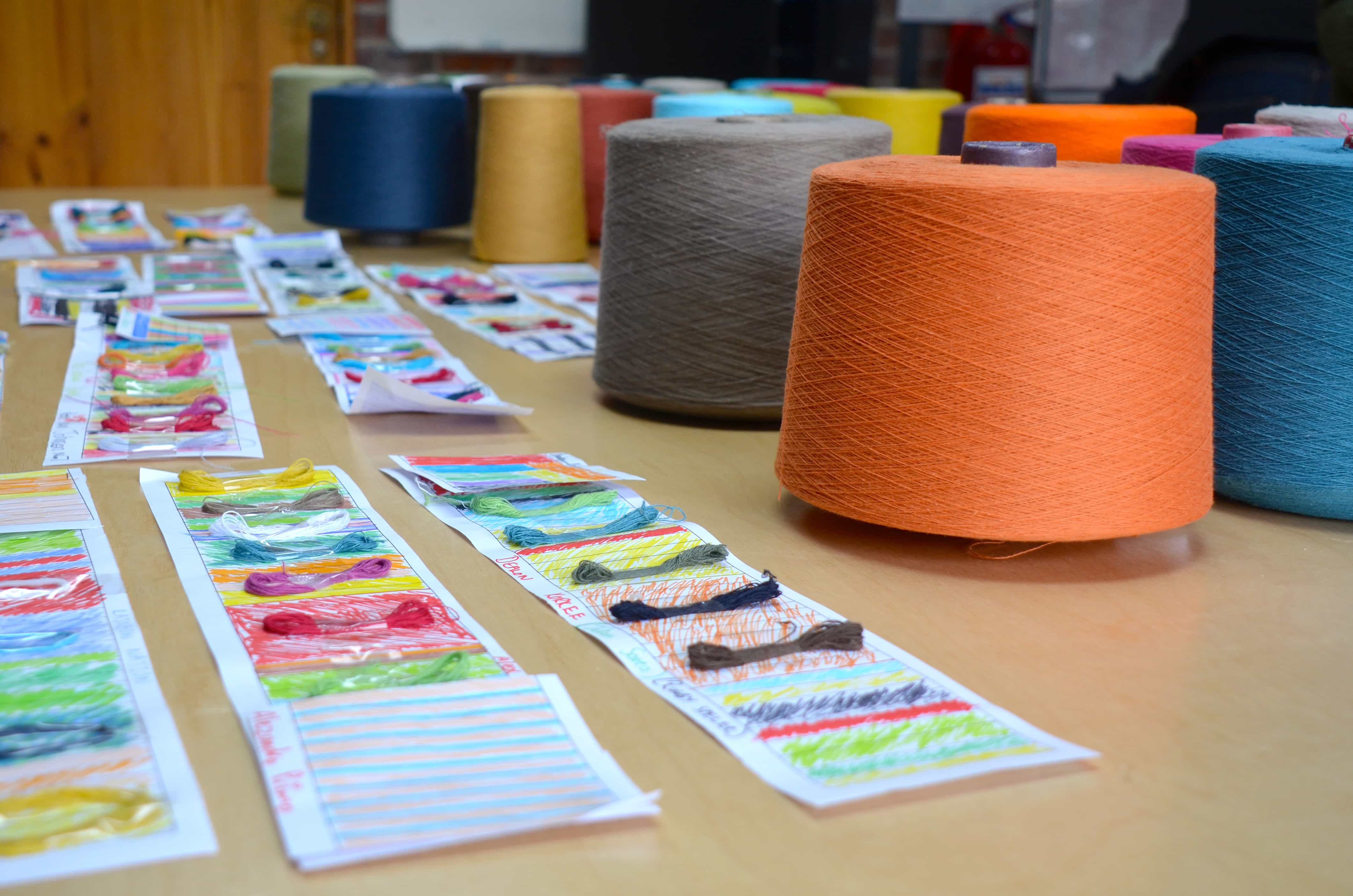 Learning about colours and selecting yarn; students from Crags Primary School were recently hosted at the Mungo Mill for a workshop in textile design