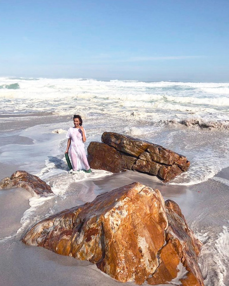 Our model, Qiniso van Damme, falling into the sea while shooting the Mungo Dhow Towel at Misty Cliffs beach