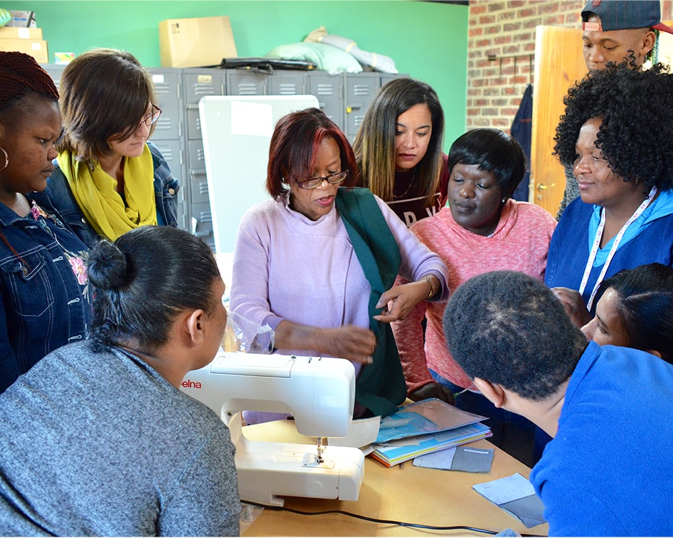 Plettenberg Bay community member, Shirley Joseph, guiding Mungo staff through a beginner sewing workshop - held in conjunction with the Mungo MOVE initiative