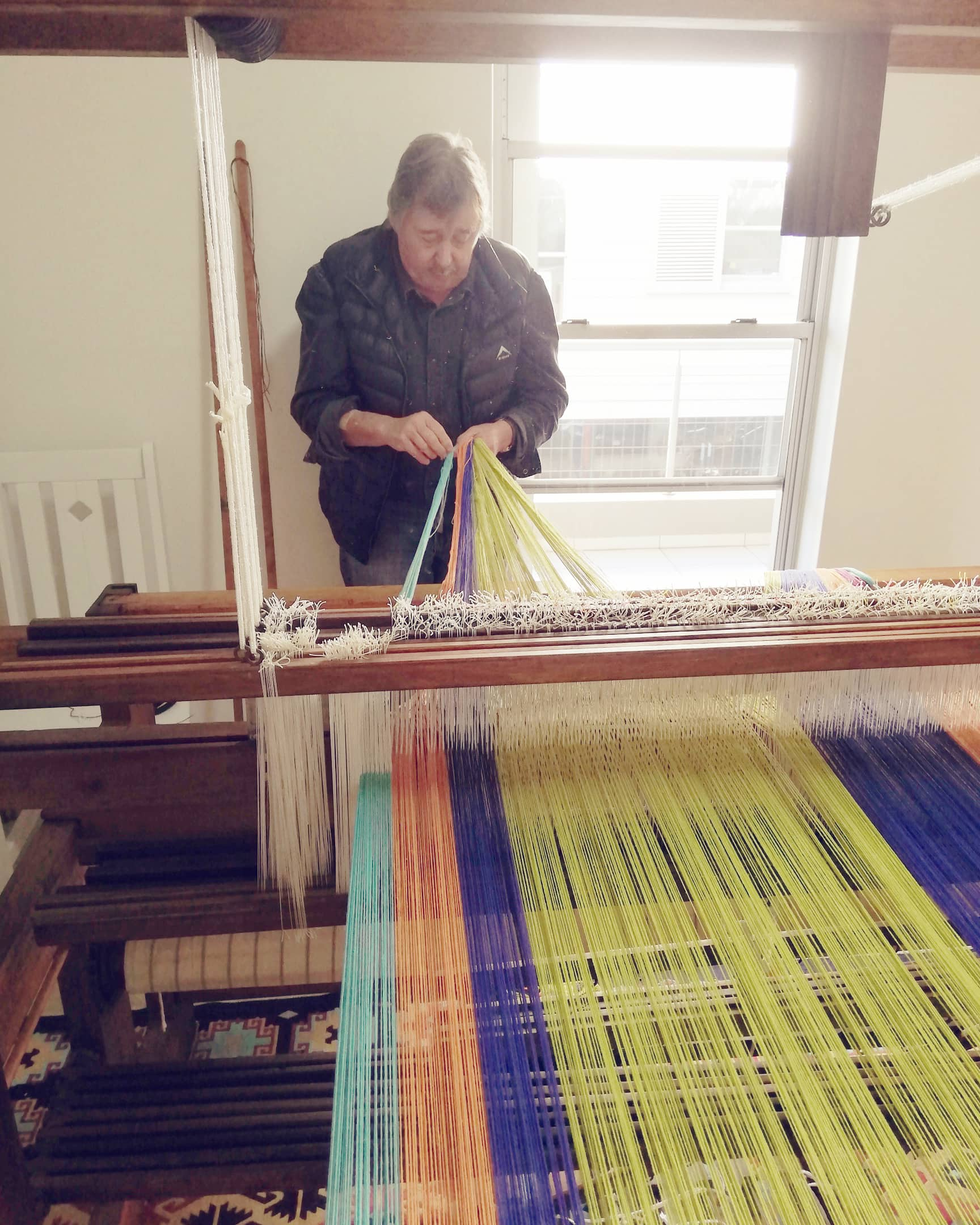 Stuart Holding, Mungo founder and Master Weaver, helping designer Lenore with her warp