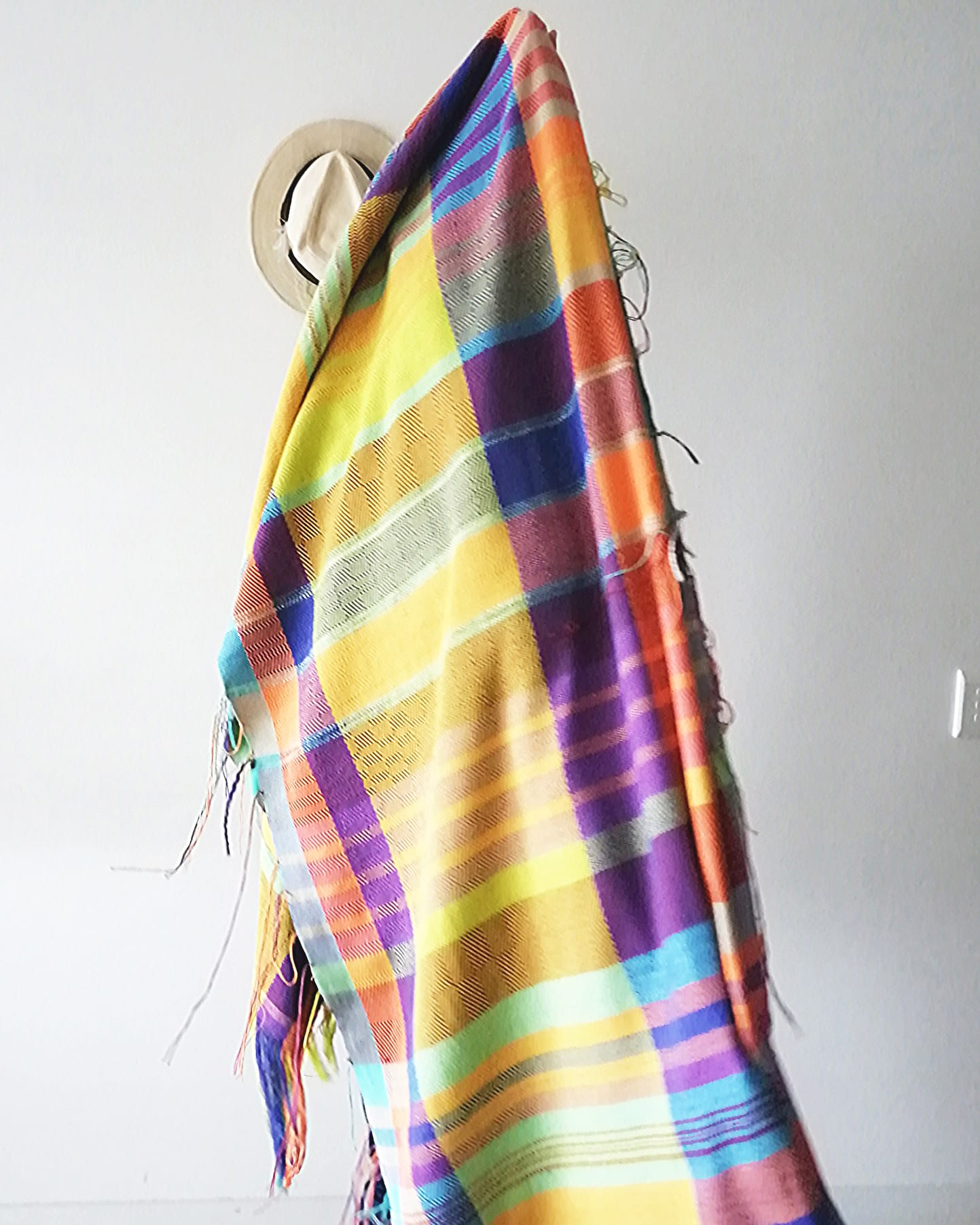 A brightly coloured checkered fabric woven by Mungo head designer, Lenore Schroeder on her handloom at home