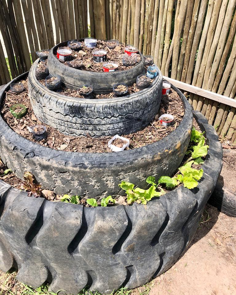 Mungo Corporate Social Responsibility - staff development gardening course. Building pyramid gardens from tyres