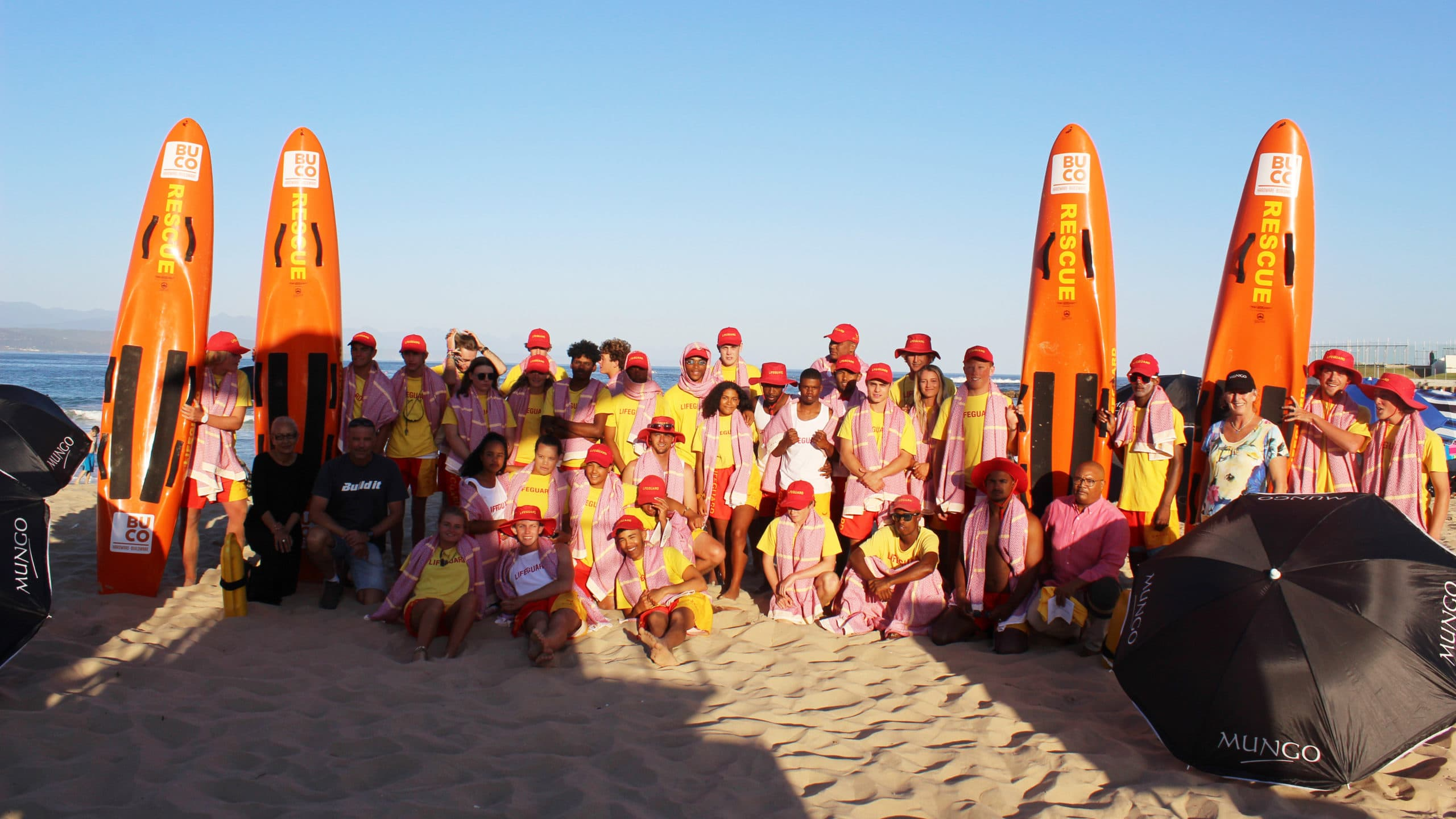 Mungo gifted the Plettenberg Bay lifeguards with limited edition red & yellow Itawuli towels