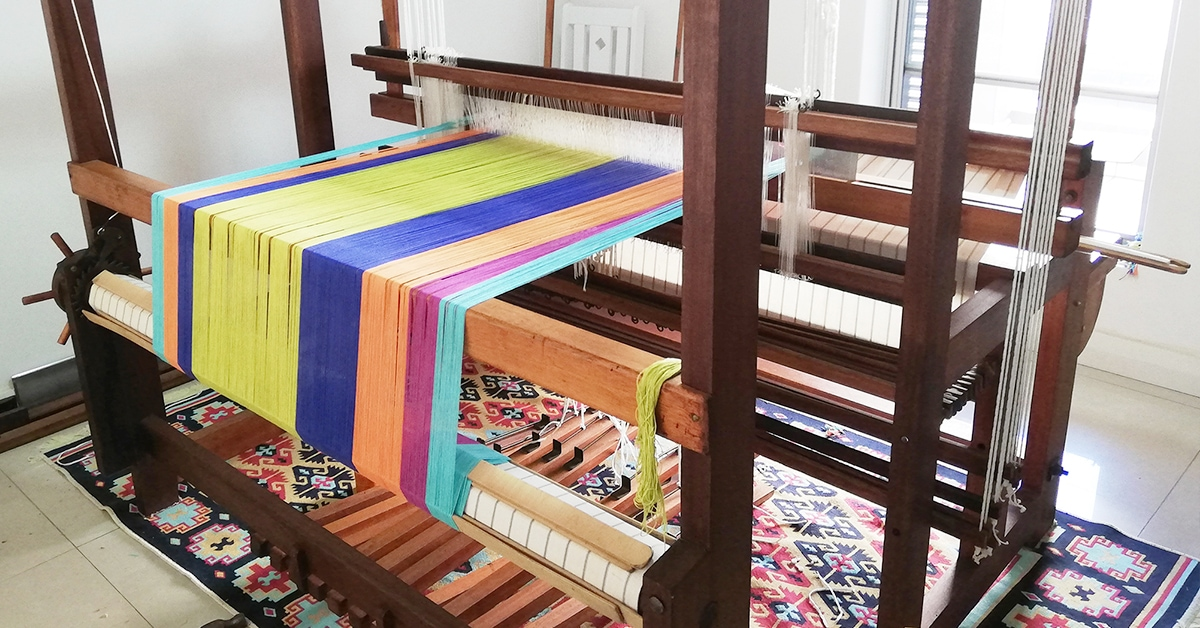 Mungo designer, Lenore Schroeder's handloom, dressed with the warp