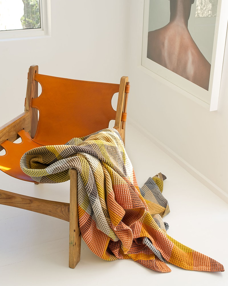 Mungo Vrou-Vrou blanket in Tamarind. A textural cotton blanket designed, woven and made in Plettenberg Bay, South Africa