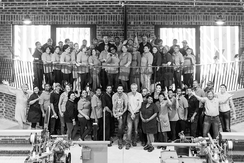 Mungo team standing together at the Mungo Mill. Homeware textiles designed, woven & Mungo in Plettenberg Bay, South Africa
