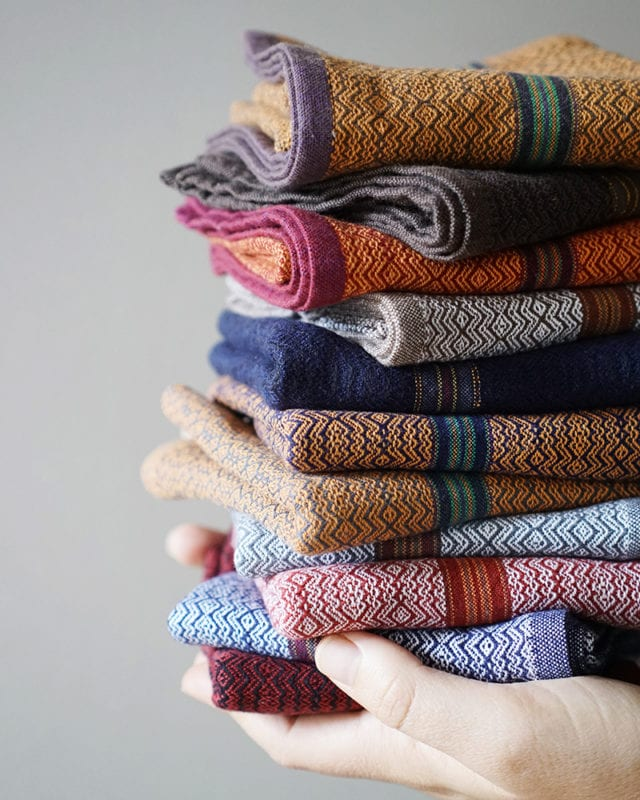 Mungo Boma Stack - a stack of 10 assorted cotton hand towels. Reusable & machine washable. Woven at the Mungo Mill